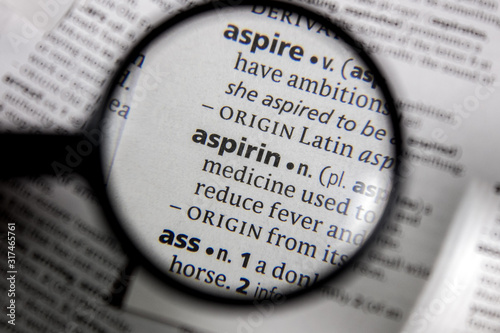 Photo The word or phrase aspirin in a dictionary.