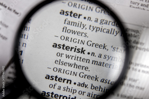 Photo The word or phrase asterisk in a dictionary.