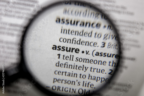 Photo The word or phrase assure in a dictionary.