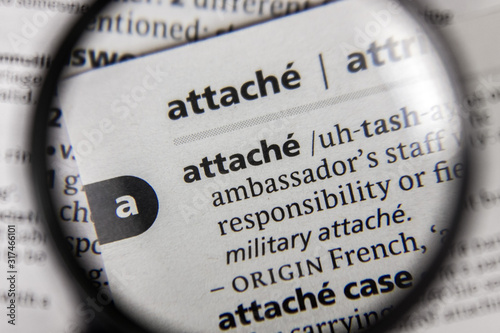 Photo The word or phrase attache in a dictionary.