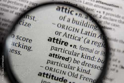 Photo The word or phrase attire in a dictionary.