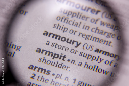 Photo Armoury word or phrase in a dictionary.