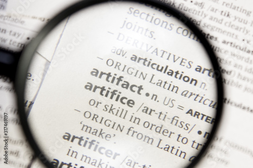 Photo Artifact and artifice word or phrase in a dictionary.