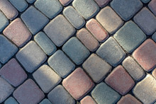 Colorful Tile Stone Texture On The Boulevard. Close Up. Top View. Copy Space.