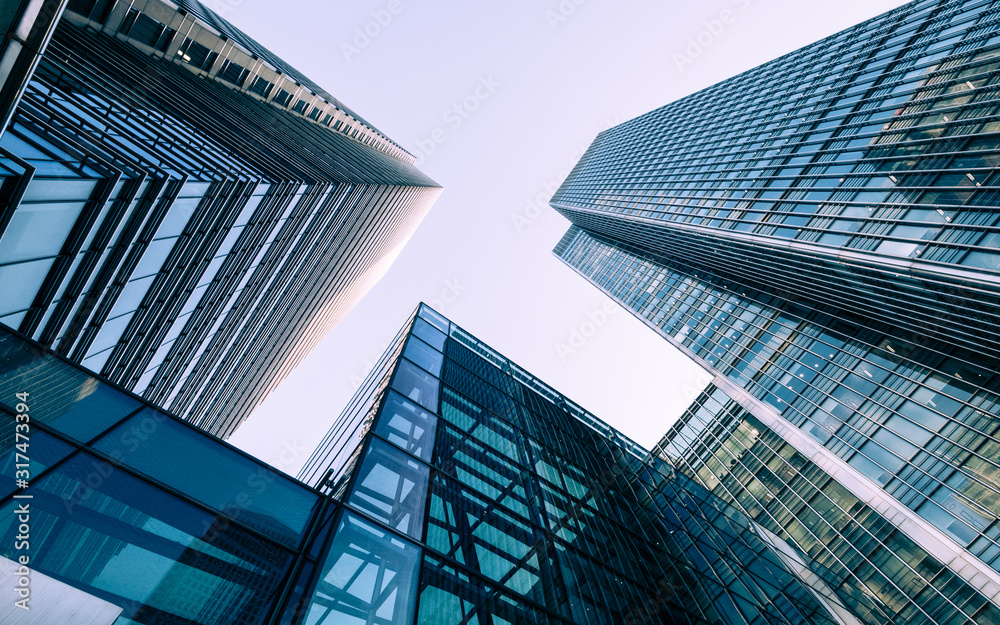 Fototapeta London Docklands skyscrapers. Low, wide angle view of converging glass and steel contemporary skyscrapers.