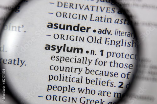 Photo The word or phrase asylum in a dictionary.