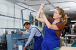 Female glazier working in glass factory