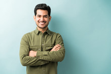 Confident Smiling Man Standing In Studio