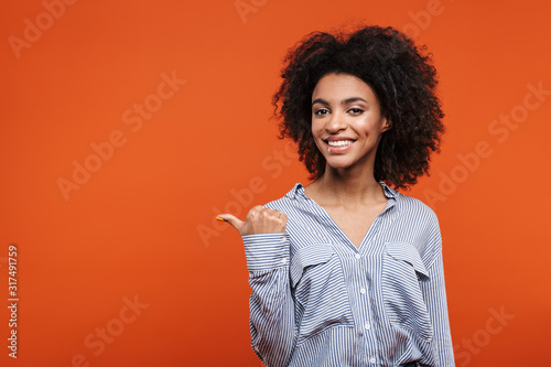 Obraz Excited pretty young african woman standing - fototapety do salonu