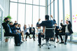 canvas print picture - Rear view of Business colleagues discussing report at modern office. Business People Raised fist while in meeting at office, The Secret to successful business concept