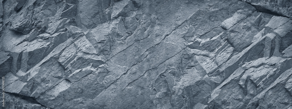Fototapeta Gray grunge banner. Abstract stone background. The texture of the stone wall. Close-up. Light gray rock backdrop.