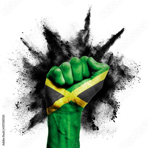 Valokuvatapetti Jamaica raised fist with powder explosion, power, protest concept