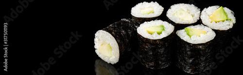 delicious sushi maki with avocado isolated on black, panoramic shot