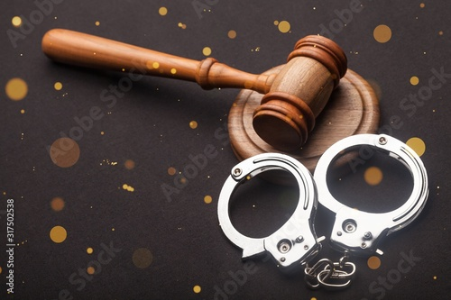 Photo Gavel and handcuffs.