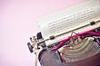 Antique Typewriter on Pink Background