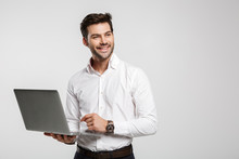 Image Of Young Cheerful Businessman Holding And Using Laptop