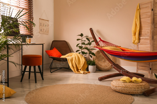 Obraz Colorful hammock with pillow in modern room interior - fototapety do salonu