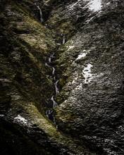 Waterfall Flow Down The Mounta...