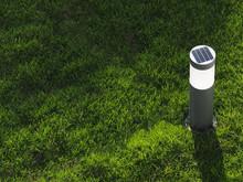 Solar Powered Garden Flashlight. Copy Space.