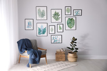 Beautiful Paintings Of Tropical Leaves On White Wall In Living Room Interior