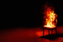 Burning Chair On A Black Backg...