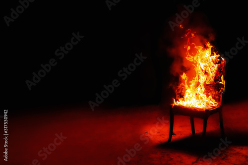 Photo Burning chair on a black background