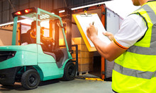Worker Holding Clipboards Control  Loading Of Shipment Goods Into A Truck Container, Freight Industry Delivery Logistics And Transport.