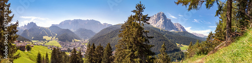 Panoramic view to Selva di Val Gardena and the mountains of the Cir Peaks, Sella, Sassolungo and Sasso Piatto, Dolomite Alps in South Tyrol, Italy