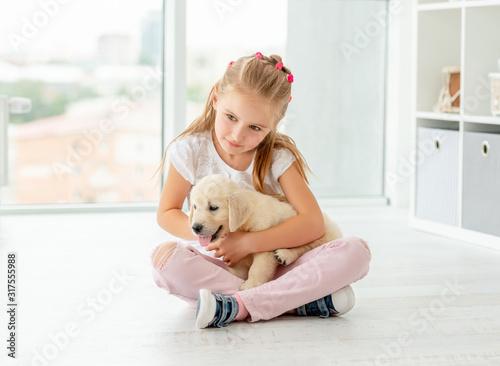 Nice girl holding puppy Wallpaper Mural