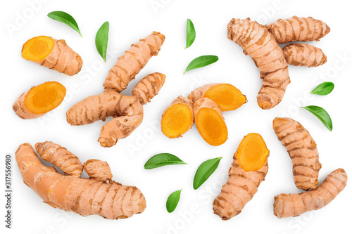Fényképezés turmeric root and slices isolated on white background