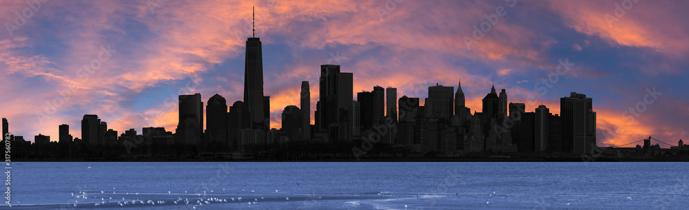 silhouette of manhattan in new york at sunset