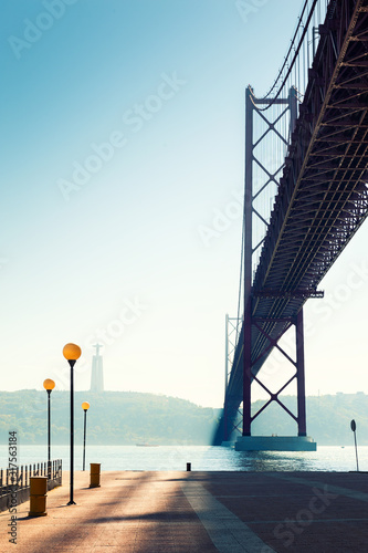 25th April Bridge on Tejo river in Lisbon, Portugal. Summer landscape.