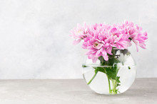 Pink Flowers In A Glass Vase O...