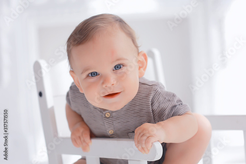 Photo toddler child in a bright studio / little boy infant beautiful healthy child