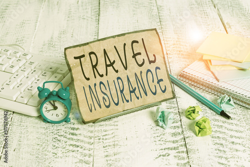 Photo Writing note showing Travel Insurance