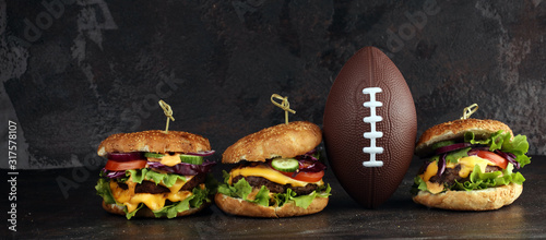 Tasty fresh meat burgers with salad and cheese. Homemade angus burger. Great for Bowl football Game angus burger - 317578107