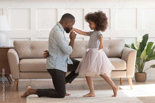 African father got down on knee kisses hand of daughter