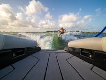 Male Wake Surfing Wave Behind ...