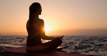 A Woman In A Lotus Position Wi...