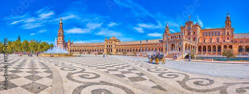 Fotografie, Obraz The tourist carriage in Plaza de Espana in Seville, Spain