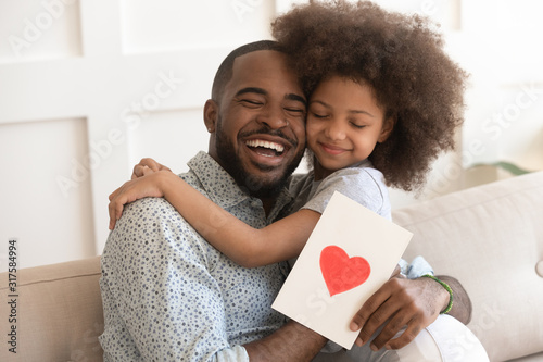 Fotografia African daddy on Father Day received from caring daughter postcard