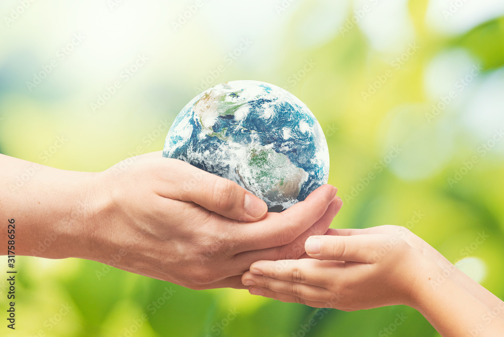 Fototapeta Earth globe in hands. World environment day. Elements of this image furnished by NASA.
