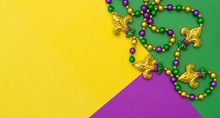 Mardi Gras Carnival Decoration Beads Yellow Green Purple Background