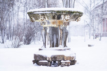 Old Frozen Fountain Is Covered...