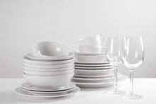 Set Of Clean Dishes On White T...