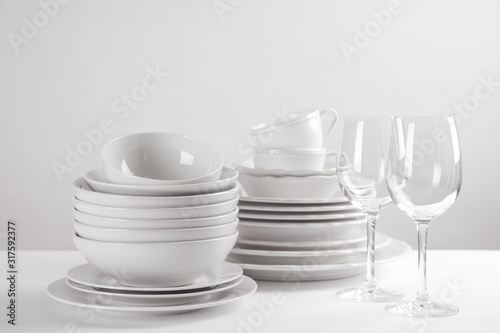 Set of clean dishes on white table Canvas Print