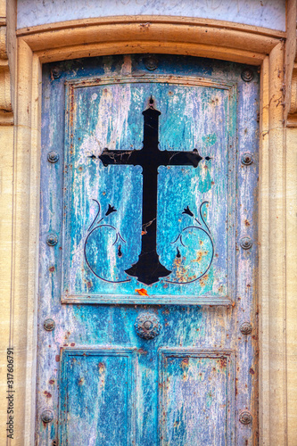 ancient gate with the sign of the cross inlaid Fototapeta