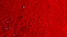 Red Background With Soap Bubbles