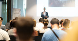 Fototapeta Kawa jest smaczna - Male speaker giving a talk in conference hall at business event. Audience at the conference hall. Business and Entrepreneurship concept. Focus on unrecognizable people in audience.