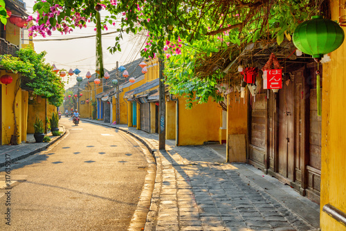 Leinwand Poster Scenic morning view of street decorated with lanterns, Vietnam